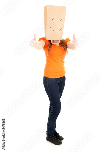 woman in smiling paper bag on head and thumbs up