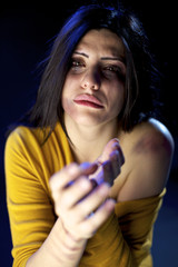 Abused woman crying asking for help after domestic violence