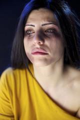 Beaten woman crying desperate