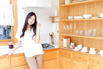 a young asian woman relaxing in the kitchen