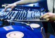 DJ plays set in vinyl player