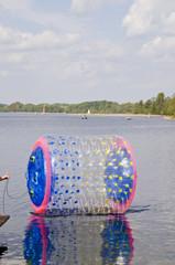 empty zorbing ball on lake water