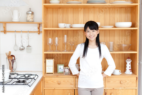 a young asian woman in the kitchen