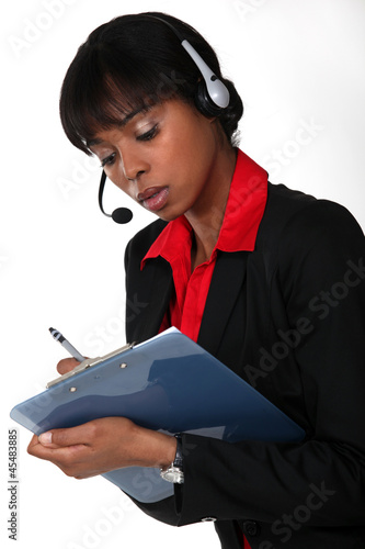 Call-center worker with clipboard
