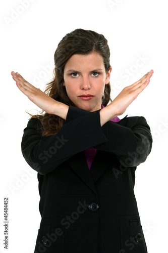 A businesswoman gesturing a stop sign.