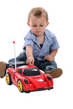 Boy playing with race car