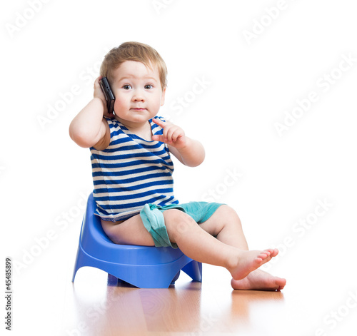 funny baby sitting on chamber pot and listening pda