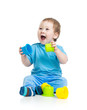 baby playing with colourful cup toys on floor, isolated over whi