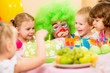 kids celebrating birthday party with clown