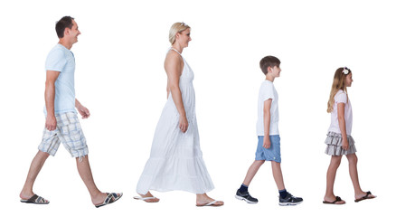 A Happy Family With Two Children Walking In A Line