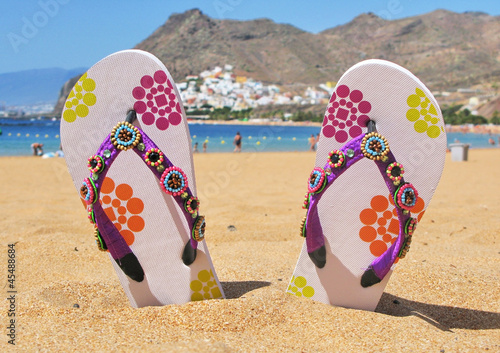 Flip-flops in the sand of Teresitas beach. Tenerife island, Cana