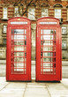 Two famous  red public phone cabins in London