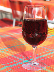 Glass of red wine on checked tablecloth