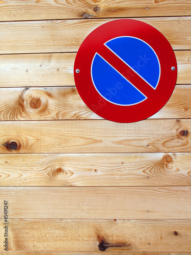 No parking sign on a wooden wall