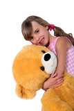 Little girl with toy bear