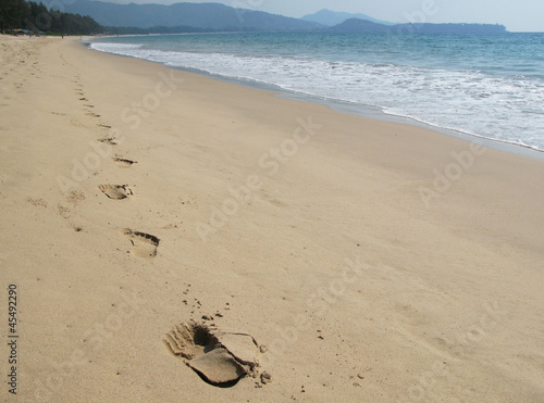 Footprints on the beach of Phuket, Thailand