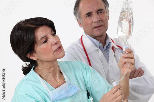 Nurse checking perfusion
