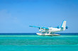 seaplane taking off over turquoise ocean