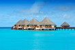 water bungalows over the ocean on maldives