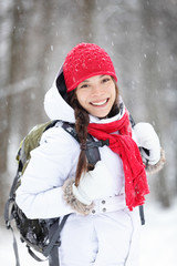 Cheerful Asian woman in falling snow
