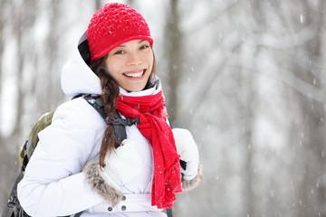 Woman winter hiking in snow