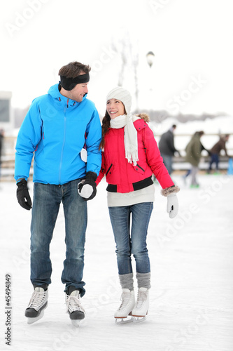 Romantic couple ice skating