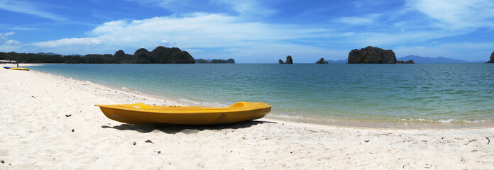 Yellow kayak on the famous Thanjung Rhu beach of Langkawi, Malay