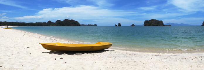 Yellow kayak on the famous Thanjung Rhu beach of Langkawi, Malay