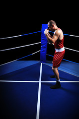 Male boxer in ring doing exercise