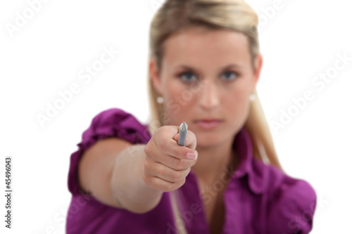Woman pointing her pen at you