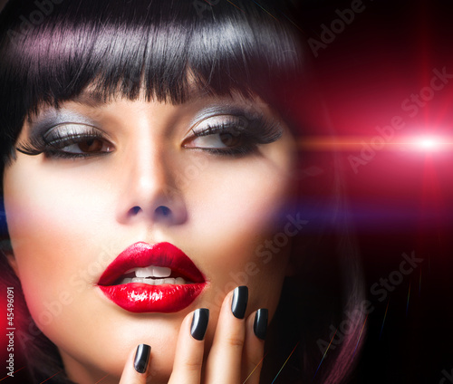 Beautiful Brunette Girl Portrait.Face.Makeup. Sensual Red Lips