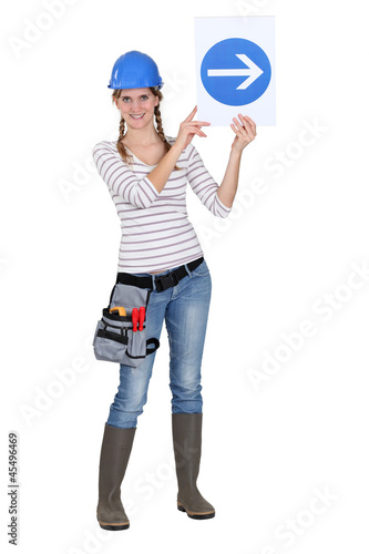 Construction worker holding up a traffic sign