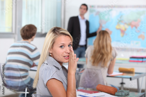 Pupil whispering in class