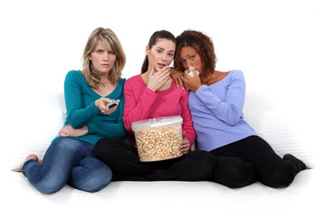 trio of girls crying over sad movie