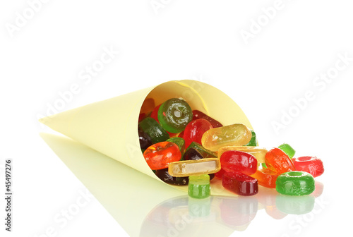 Tasty colorful candies in bright bag isolated on white