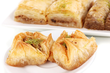 Sweet baklava on plates close-up