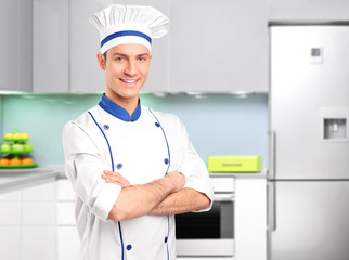 Male chef posing in a kitchen