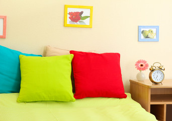 Empty bed with pillows and sheets in bedroom