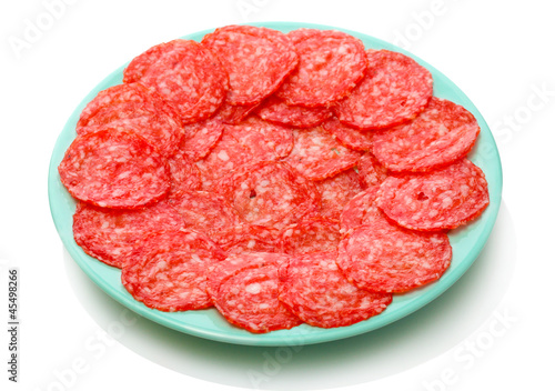 tasty sausage on plate, isolated on white