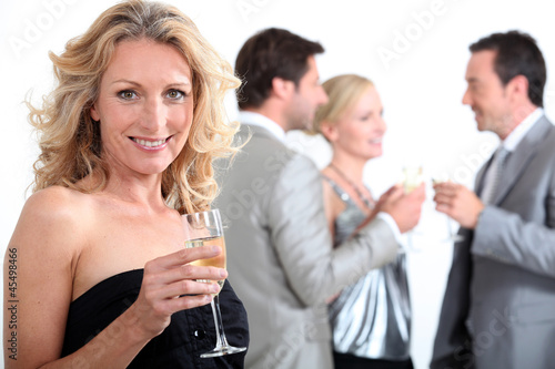 Group of people with drink in hand