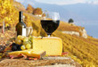 Red wine, cheese and grapes on the terrace of vineyard in Lavaux