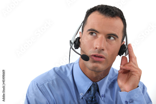 Man speaking into a hands-free headset