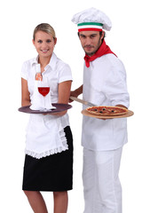 Pizza chef standing next to a wine waitress
