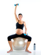 Beautiful pregnant woman at fitness gym