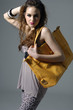 Pretty young girl model with big leather bag