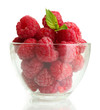 ripe raspberries with mint in glass bowl isolated on white