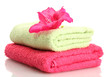 bright towels and flower isolated on white