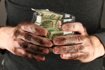 homeless holds bank with money, close-up