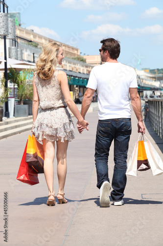 Couple shopping in the street