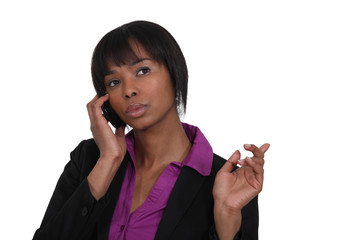 beautiful Afro-American businesswoman talking on her cell